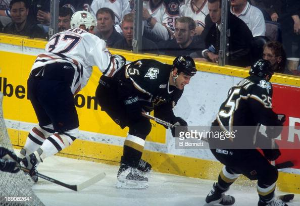 Darryl Sydor of the Dallas Stars is checked by Dan Cleary of the Edmonton Oilers during Game 3 of the 2000 Conference QuarterFinals on April 16 2000...