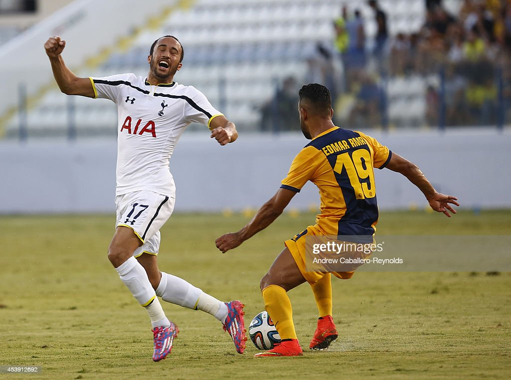 Darryl Townsend Andros (L) from Tottenham Hotspur fights for the ball against Edmar Lacerda da Silva from AEL Limassol FC during the AEL Limassol FC v Tottenham Hotspur - UEFA Europa League Qualifying Play-Off match on August 21, 2014 in Larnaca, Cyprus.