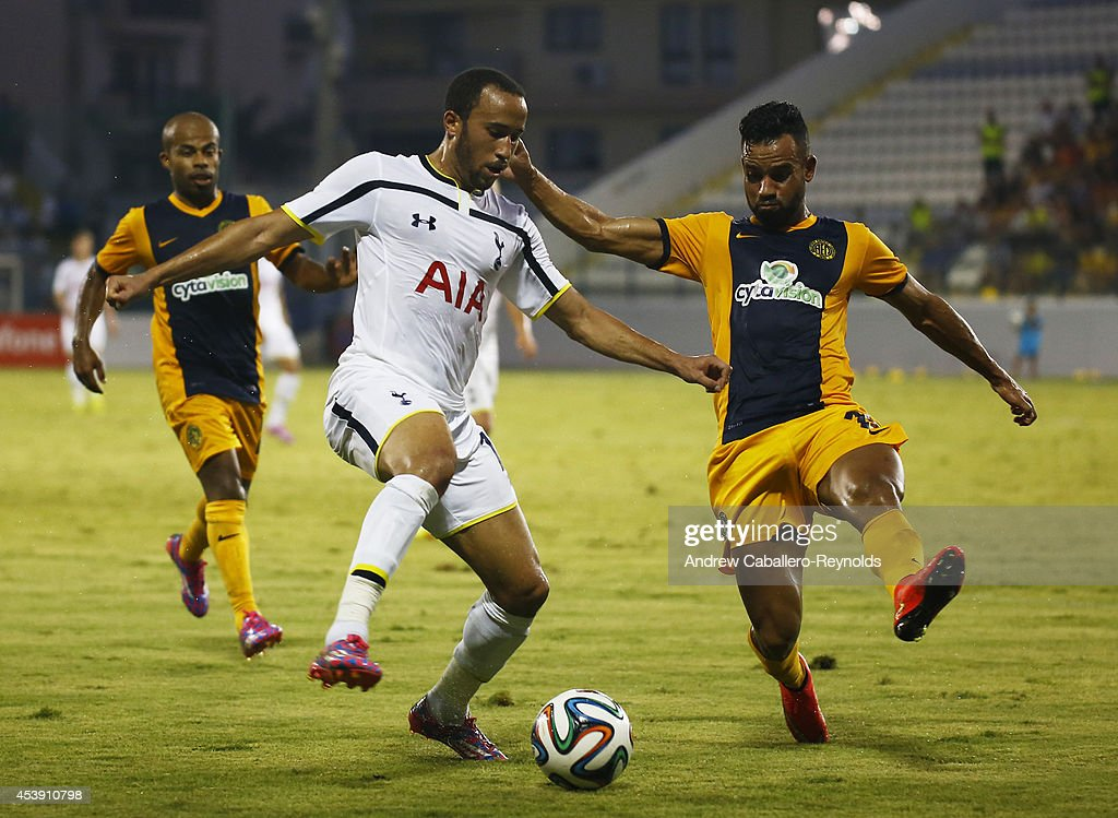 Darryl Townsend Andros (C) from Tottenham Hotspurfights for the ball with Edmar Lacerda da Silva from AEL Limassol FC during the AEL Limassol FC v Tottenham Hotspur - UEFA Europa League Qualifying Play-Off match on August 21, 2014 in Larnaca, Cyprus.