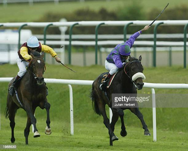 Darryll Holland and Franklins Garden lead the Pat Eddery riden Let Me Try Again home to land The Bet Atheraces on 08000838383 Derby Trial Race run at...
