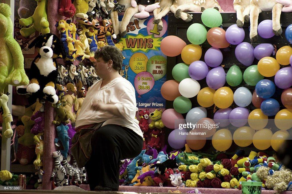 Dart balloons at a traveling carnival, Pier 4 Park : Stock Photo