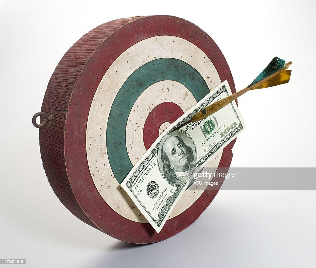 Dart board hundred dollar bill : Stock Photo