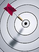 A Dart Hitting Bulls Eye on a Dartboard