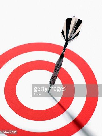 Dart in Target Bull's Eye