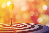 selective focus of old dart target with arrows over bokeh background ,abstract background to target concept.
