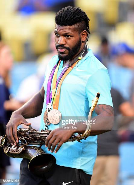 Dartanyon Crockett reacts after playing the National Anthem on his saxophone before the game between the Atlanta Braves and the Los Angeles Dodgers...