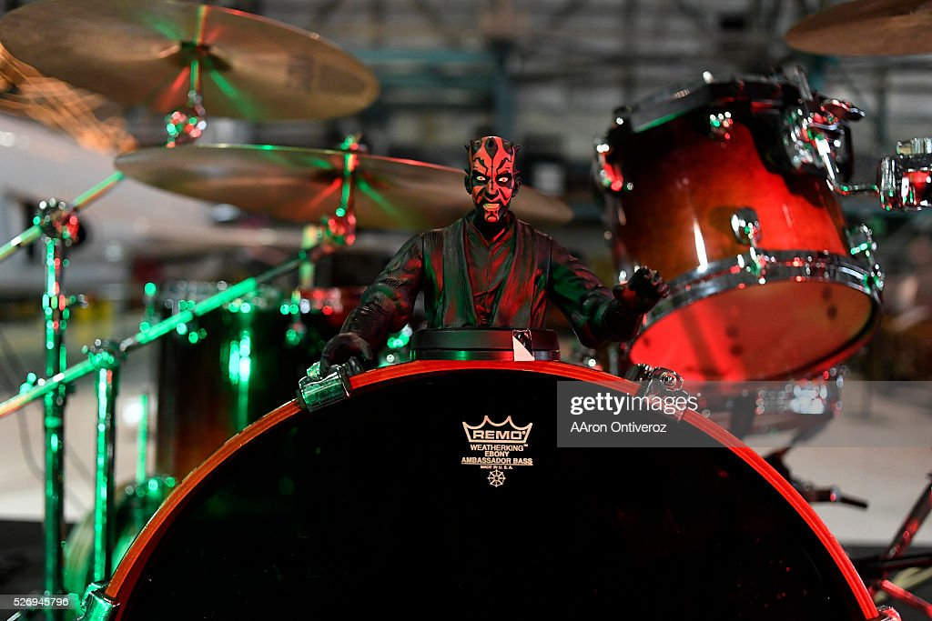 Darth Maul sits on a drum kit after the Fabulous Boogienauts performed during a Star Wars themed day at Wings Over the Rockies on Sunday, May 1, 2016.