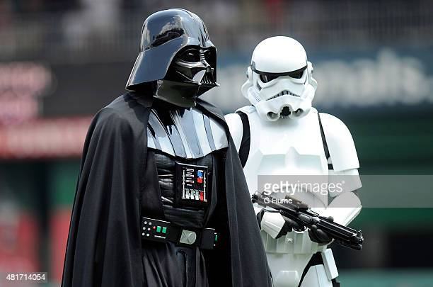 Darth Vader and a Stormtrooper stand on the field for Star Wars day before the game between the Washington Nationals and the Los Angeles Dodgers...