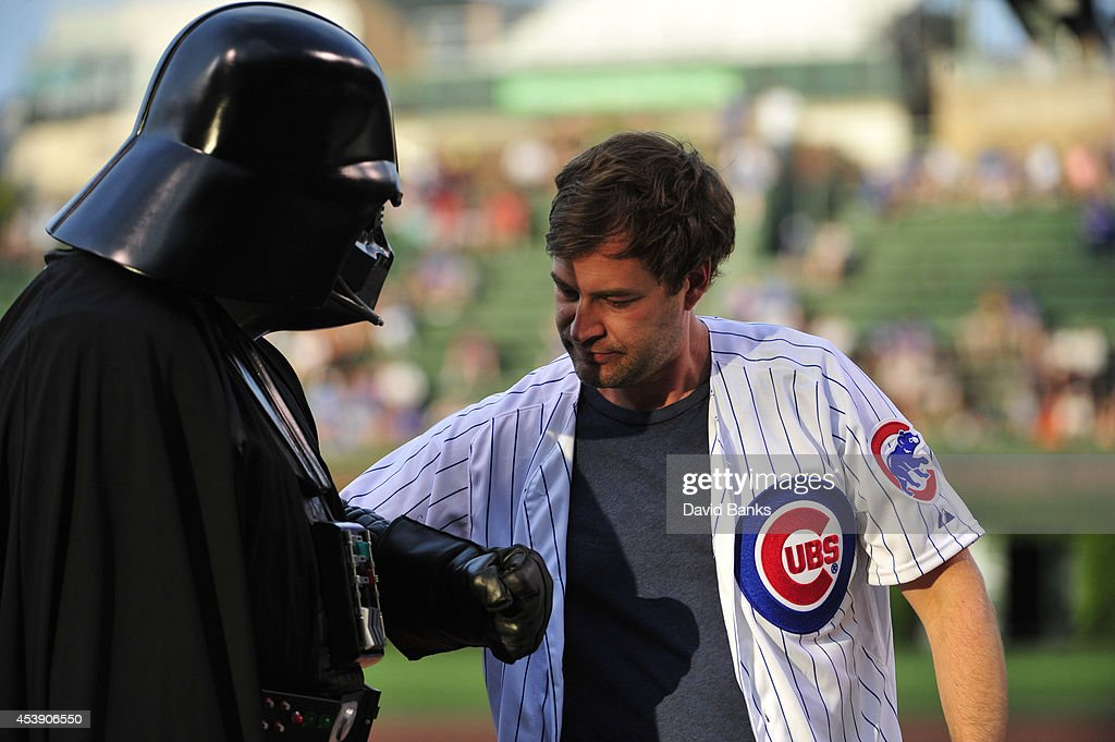 Darth Vader and <a gi-track='captionPersonalityLinkClicked' href=/galleries/search?phrase=Mark+Duplass&family=editorial&specificpeople=572703 ng-click='$event.stopPropagation()'>Mark Duplass</a> wait to throw out the ceremonial first pitch before the game between the Chicago Cubs and the San Francisco Giants on Star Wars Night on August 20, 2014 at Wrigley Field in Chicago, Illinois.