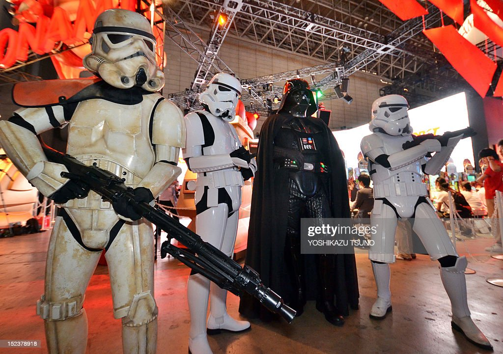 Darth Vader and Storm Troopers pose for visitors for the demonstration of the Star Wars videogame software at the software developer Konami's booth during the annual Tokyo Game Show in Chiba, suburban Tokyo, on September 20, 2012. Some 200 companies exhibited their latest video game hardware and software with some 200,000 people expected to visit the four-day vent. AFP PHOTO / Yoshikazu TSUNO