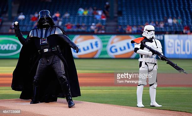 Darth Vader character from 501st Legion throws out the ceremonial first pitch as a storm trooper character looks on before the Seattle Mariners take...