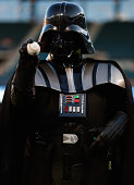 Darth Vader character from 501st Legion throws out the ceremonial first pitch before the Seattle Mariners take on the Texas Rangers at Globe Life...