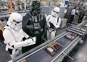 'Darth Vader' flanked by two Stormtroopers watches the production of 'Trivial Pursuit DVD Star Wars Saga Edition' at the Hasbro Games manufacturing...