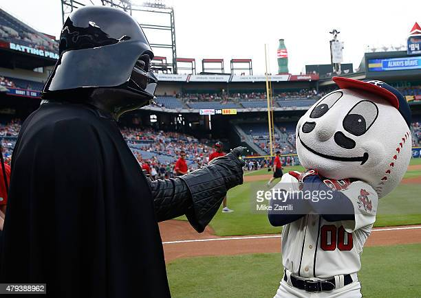 Darth Vader pretends to put a choking spell on Homer the Brave during Star Wars Night festivities before the game between the Philadelphia Phillies...