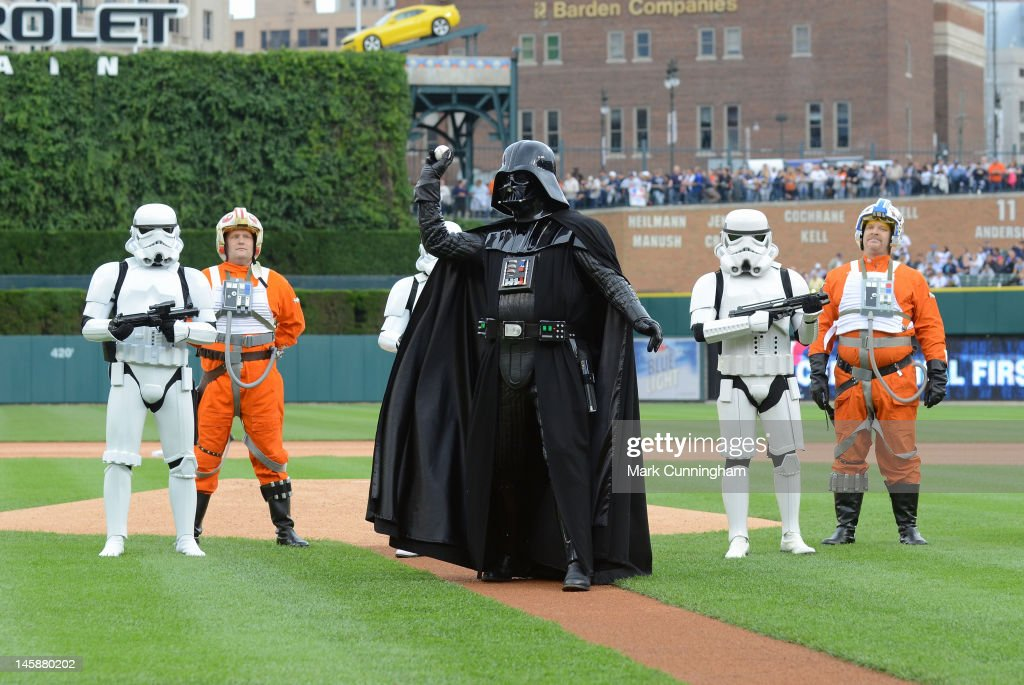 Darth Vader throws out the ceremonial first pitch while surrounded by other characters during Star Wars Night before the game between the Detroit Tigers and the New York Yankees at Comerica Park on June 2, 2012 in Detroit, Michigan. The Tigers defeated the Yankees 4-3.