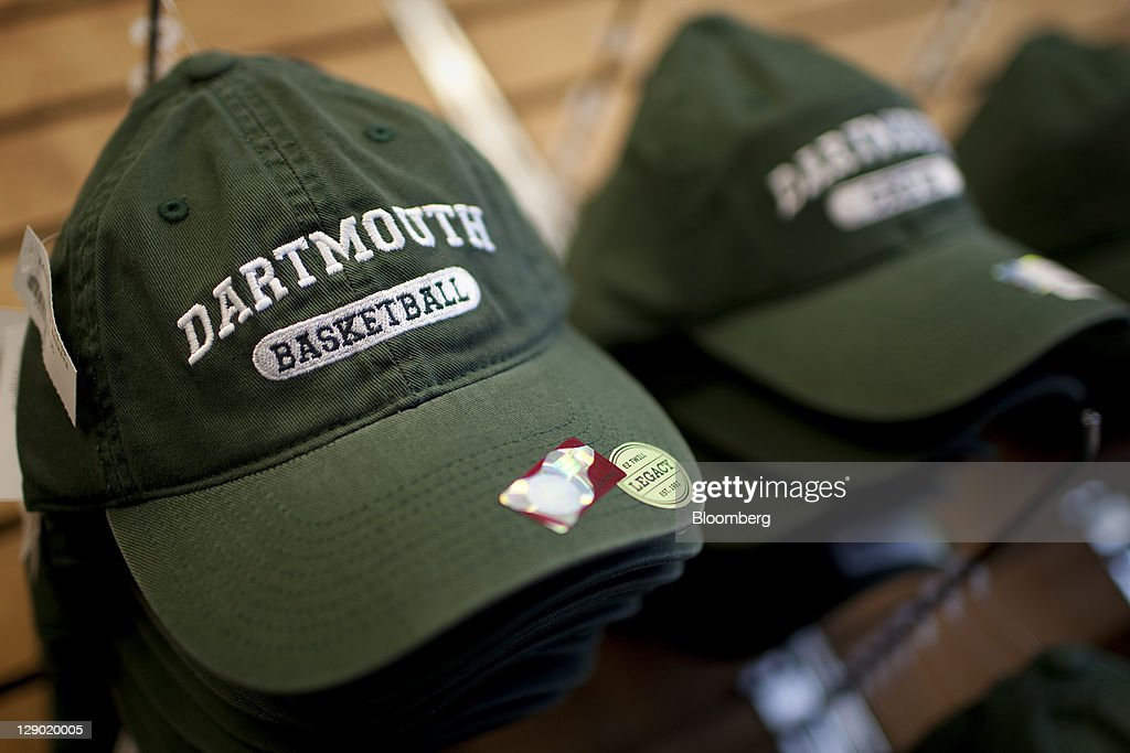 Dartmouth College baseball hats are displayed for sale at a store on campus the day before a Republican presidential debate sponsored by Bloomberg...