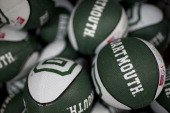 Dartmouth College basketballs are displayed for sale at a store on campus the day before a Republican presidential debate sponsored by Bloomberg via...