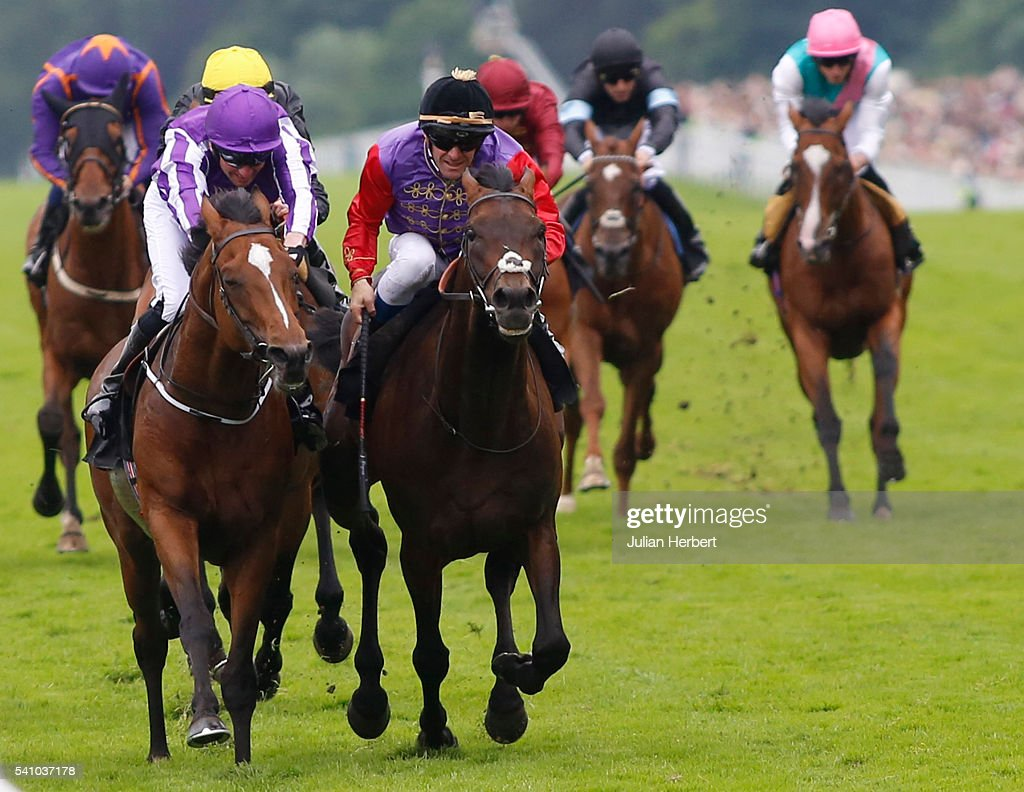 Dartmouth ridden by Olivier Peslier gets the better of Highland Reel ridden by Seamie Heffernan to win The Hardwicke Stakes Race run during Day Five...