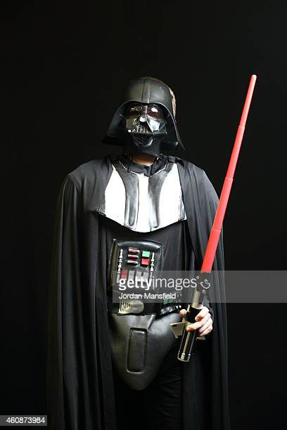 A darts fan dressed as Darth Vader poses ahead of Day Eight of the William Hill PDC World Darts Championships at Alexandra Palace on December 28 2014...