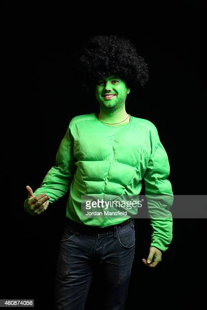 A darts fan dressed as the Incredible Hulk poses ahead of Day Eight of the William Hill PDC World Darts Championships at Alexandra Palace on December...