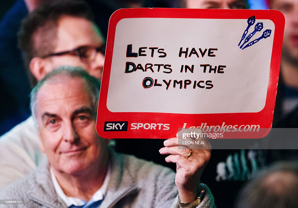 A darts fan holds a sign ahead of the PDC World Championship darts final between Phil Taylor of Britain and Michael van Gerwen of the Netherlands, at Alexandra Palace in north London on January 1, 2013. AFP PHOTO/Leon Neal