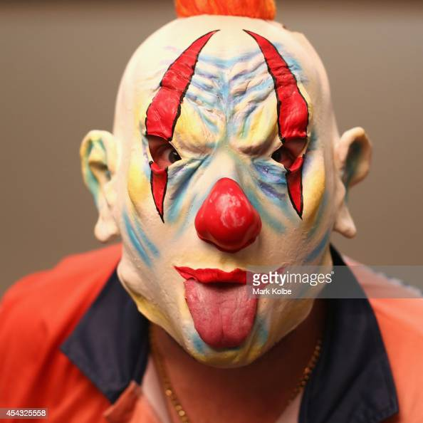A darts fan in an evil clown mask fancy dress poses as they arrive during the Sydney Darts Masters at Hordern Pavilion on August 29 2014 in Sydney...