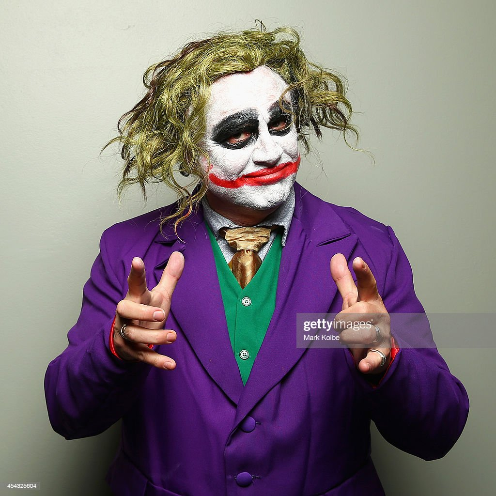 A darts fan in The Joker fancy dress poses as they arrive during the Sydney Darts Masters at Hordern Pavilion on August 29 2014 in Sydney Australia