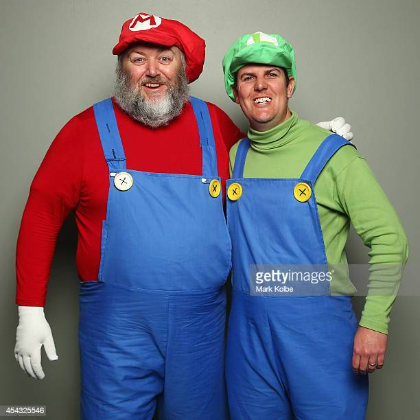 Darts fans in Mario Bros fancy dress pose as they arrive during the Sydney Darts Masters at Hordern Pavilion on August 29 2014 in Sydney Australia