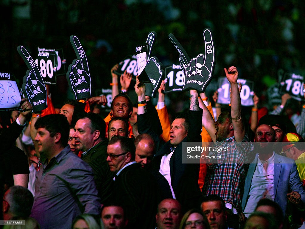 Darts fans react during the Betway Premier League at The 02 Arena on May 21 2015 in London England