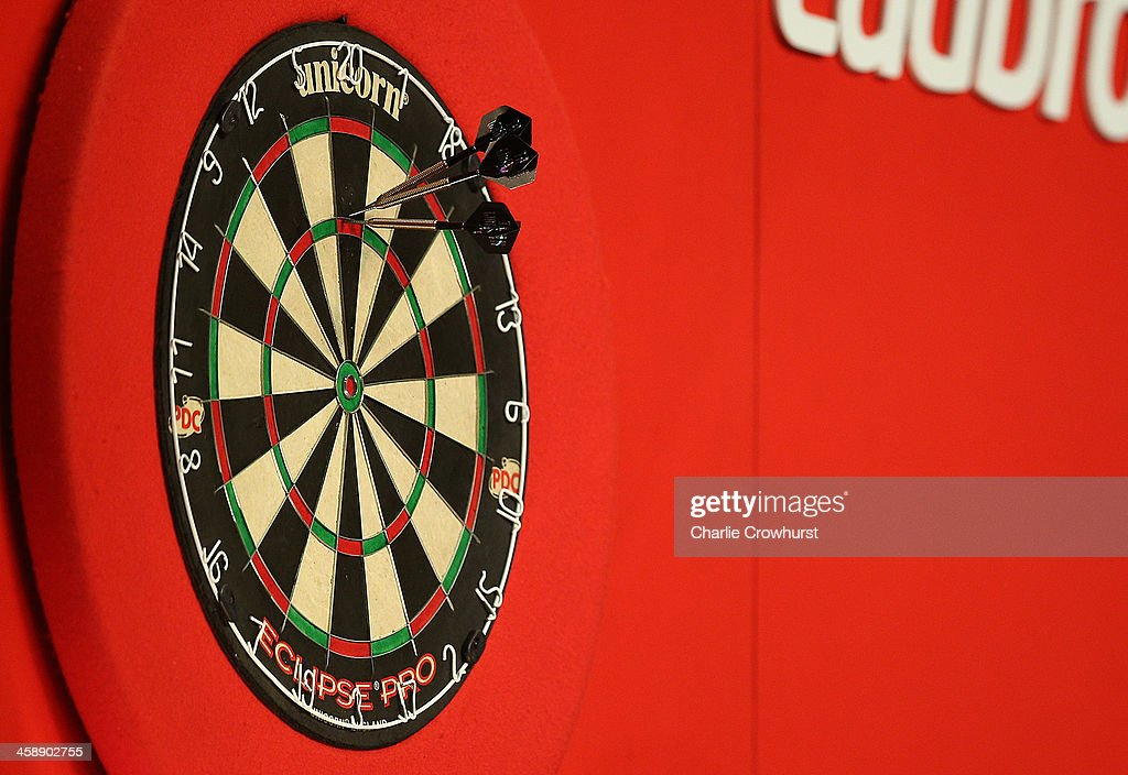 Darts in the dart board during the Ladbrokescom World Darts Championship on Day Ten at Alexandra Palace on December 22 2013 in London England