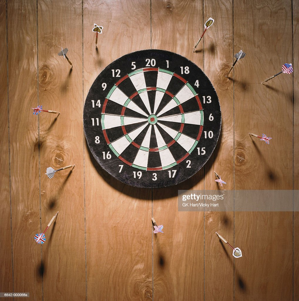 Darts in Wall : Stock Photo