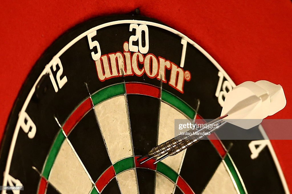 Darts scoring a 180 sit the board during Day Two of the William Hill PDC World Darts Championships at Alexandra Palace on December 19 2014 in London...