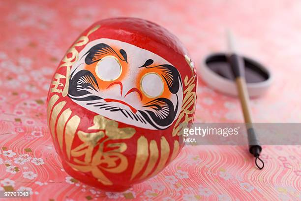 Daruma doll and calligraphy brush