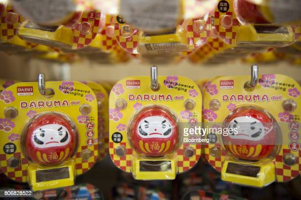 Daruma doll toys are displayed for sale at a Daiso store operated by Daiso Sangyo Corp in the Harajuku area of Tokyo Japan on Friday June 30 2017...