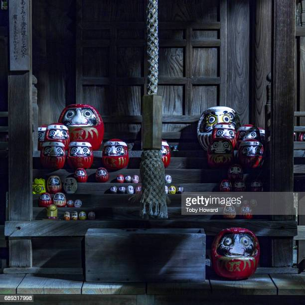 Daruma dolls in Japanse shinto shrine