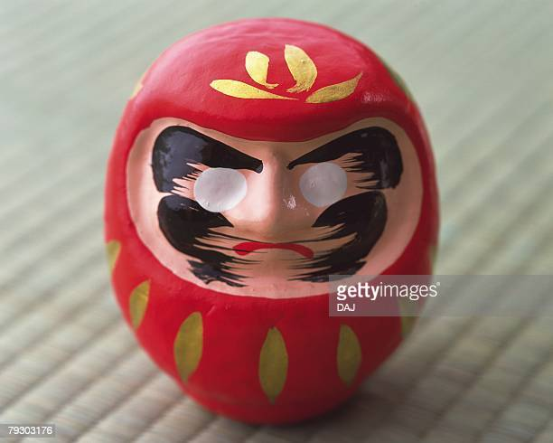 Daruma on Tatami mat, high angle view, differential focus