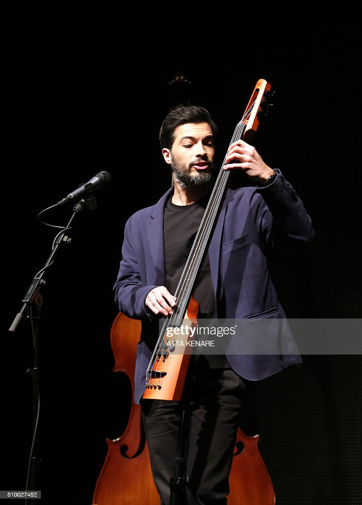 Daruosh Azar, musician for Iranian pop singer Omid Nemati, performs on stage during the 31th Fajr International Music Festival in the capital Tehran, on February 13, 2016. / AFP / ATTA KENARE