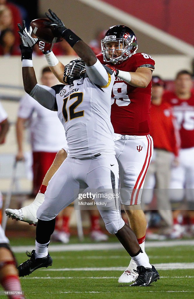 Darvin Ruise #12 of the Missouri Tigers intercepts the ball in front of Anthony Corsaro #88 of the Indiana Hoosiers at Memorial Stadium on September 21, 2013 in Bloomington, Indiana. Missour defeated Indiana 45-28.
