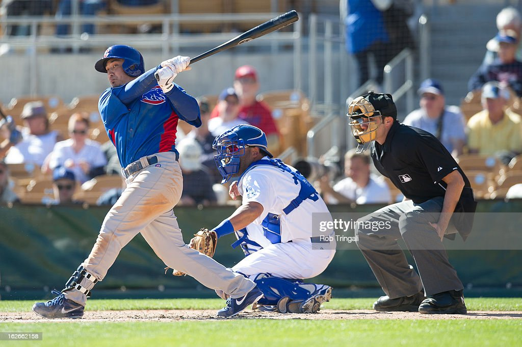 <a gi-track='captionPersonalityLinkClicked' href=/galleries/search?phrase=Darwin+Barney&family=editorial&specificpeople=537975 ng-click='$event.stopPropagation()'>Darwin Barney</a> #15 of the Chicago Cubs bats during a spring training game against the Los Angeles Dodgers at Camelback Ranch on February 25, 2013 in Glendale, Arizona.