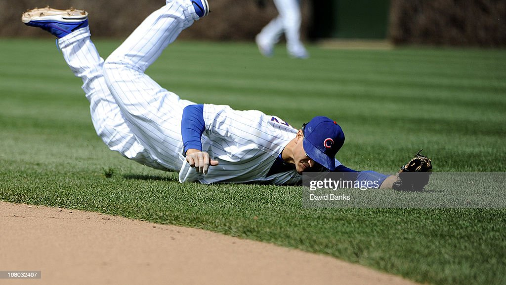 <a gi-track='captionPersonalityLinkClicked' href=/galleries/search?phrase=Darwin+Barney&family=editorial&specificpeople=537975 ng-click='$event.stopPropagation()'>Darwin Barney</a> #15 of the Chicago Cubs dives for a single off the bat of Joey Votto #19 of the Cincinnati Reds during the ninth inning on May 4, 2013 at Wrigley Field in Chicago, Illinois. The Cincinnati Reds defeated the Chicago Cubs 6-4.