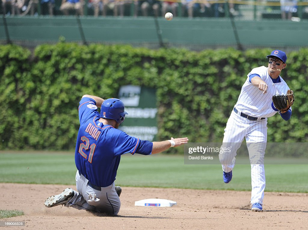 <a gi-track='captionPersonalityLinkClicked' href=/galleries/search?phrase=Darwin+Barney&family=editorial&specificpeople=537975 ng-click='$event.stopPropagation()'>Darwin Barney</a> #15 of the Chicago Cubs forces out <a gi-track='captionPersonalityLinkClicked' href=/galleries/search?phrase=Lucas+Duda&family=editorial&specificpeople=7172550 ng-click='$event.stopPropagation()'>Lucas Duda</a> #21 of the New York Mets during the sixth inning on May 18, 2013 at Wrigley Field in Chicago, Illinois.
