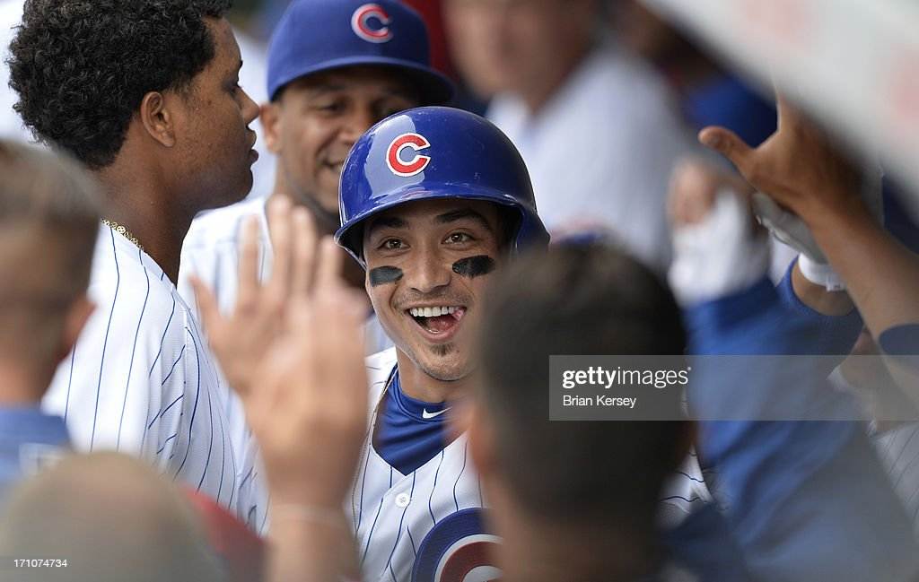 Darwin Barney #15 of the Chicago Cubs is greeted in the dugout after hitting a solo home run during the fifth inning against the Houston Astros at Wrigley Field on June 21, 2013 in Chicago, Illinois.