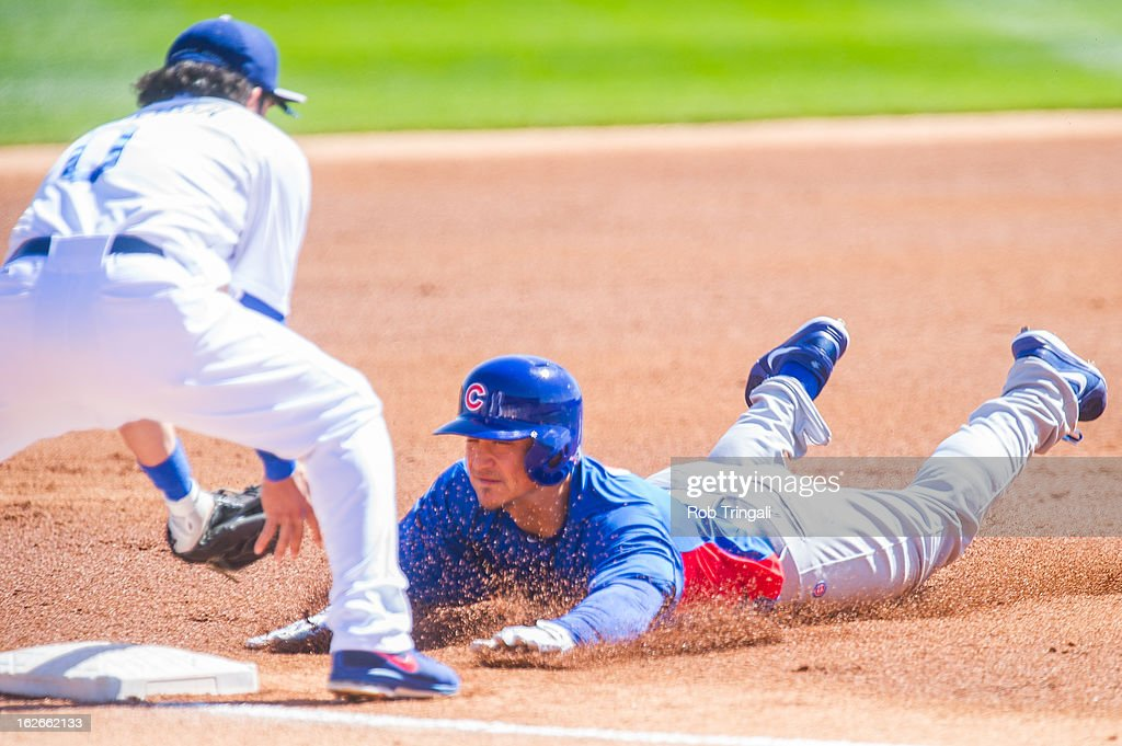 <a gi-track='captionPersonalityLinkClicked' href=/galleries/search?phrase=Darwin+Barney&family=editorial&specificpeople=537975 ng-click='$event.stopPropagation()'>Darwin Barney</a> #15 of the Chicago Cubs is thrown out at third base after doubling by <a gi-track='captionPersonalityLinkClicked' href=/galleries/search?phrase=Alfredo+Amezaga&family=editorial&specificpeople=239472 ng-click='$event.stopPropagation()'>Alfredo Amezaga</a> #0 of the Los Angeles Dodgers during a spring training game at Camelback Ranch on February 25, 2013 in Glendale, Arizona.