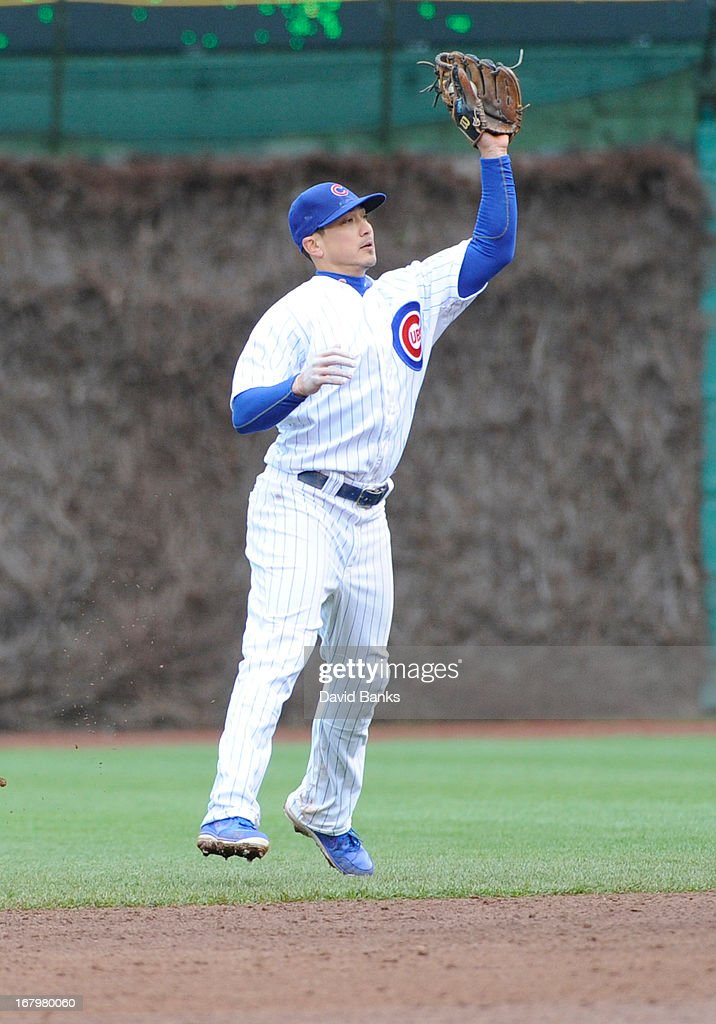 <a gi-track='captionPersonalityLinkClicked' href=/galleries/search?phrase=Darwin+Barney&family=editorial&specificpeople=537975 ng-click='$event.stopPropagation()'>Darwin Barney</a> #15 of the Chicago Cubs makes a catch against the Cincinnati Reds during the ninth inning on May 3, 2013 at Wrigley Field in Chicago, Illinois. The Reds defeated the Cubs 6-5.