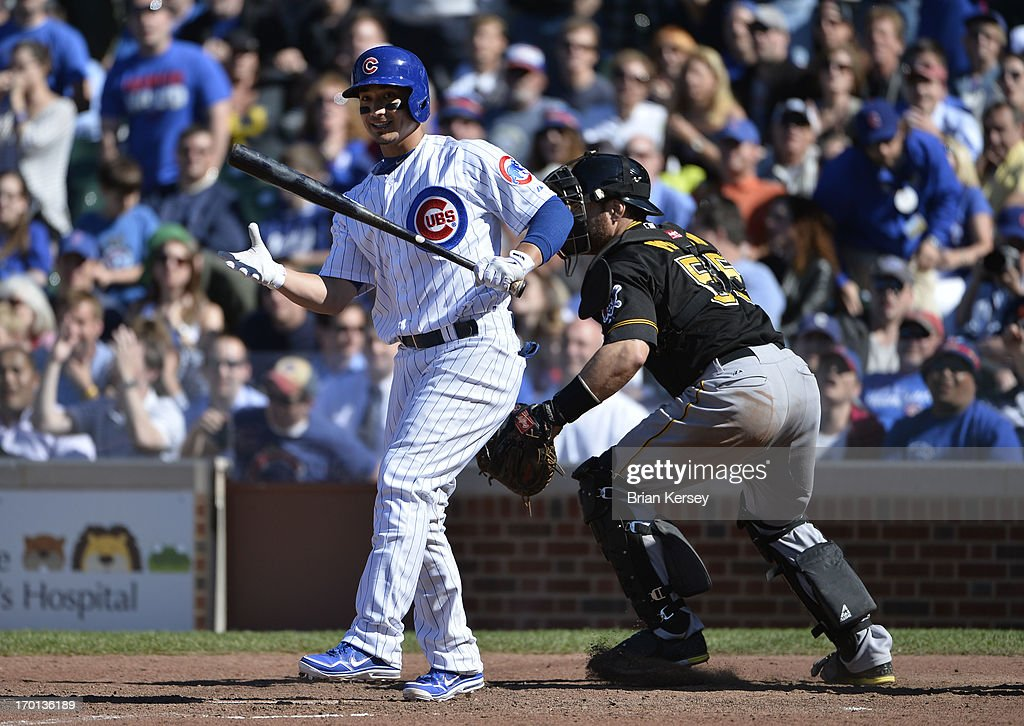 <a gi-track='captionPersonalityLinkClicked' href=/galleries/search?phrase=Darwin+Barney&family=editorial&specificpeople=537975 ng-click='$event.stopPropagation()'>Darwin Barney</a> #15 of the Chicago Cubs reacts after striking out for the final out of the ninth inning as catcher <a gi-track='captionPersonalityLinkClicked' href=/galleries/search?phrase=Russell+Martin+-+Baseball+Player&family=editorial&specificpeople=13764024 ng-click='$event.stopPropagation()'>Russell Martin</a> #55 of the Pittsburgh Pirates heads to the mound to celebrate at Wrigley Field on June 7, 2013 in Chicago, Illinois. The Pirates defeated the Cubs 2-0.