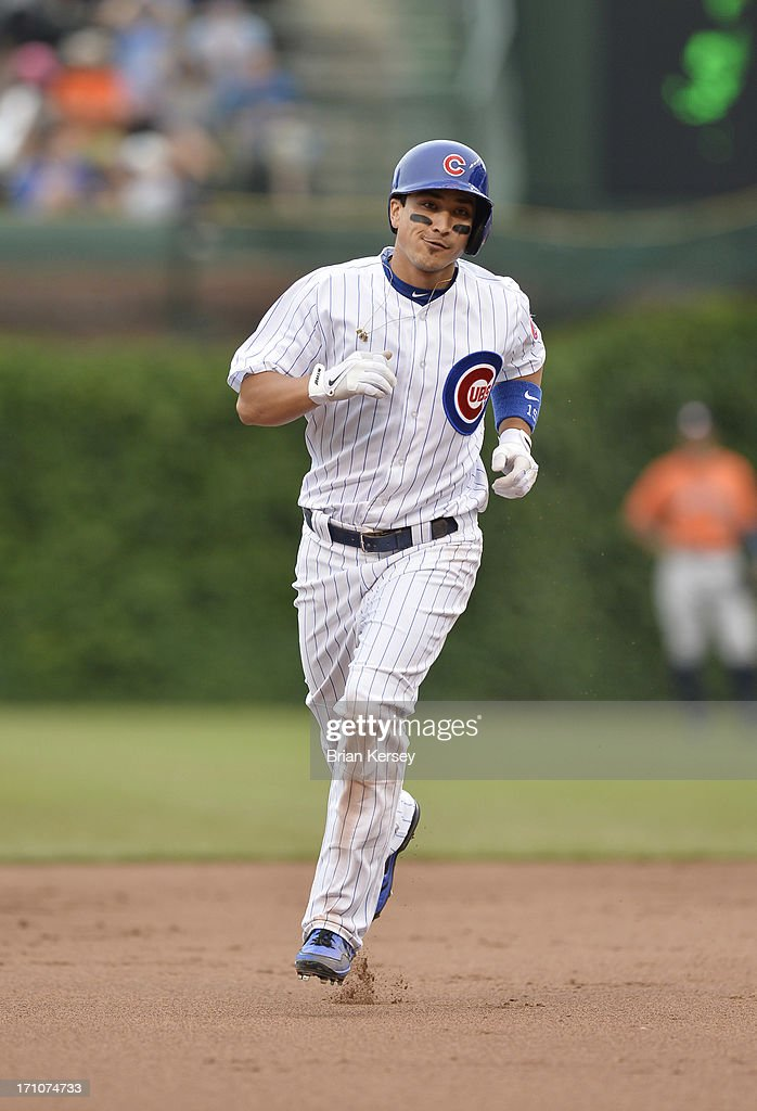 Darwin Barney #15 of the Chicago Cubs rounds the bases after hitting a solo home run during the fifth inning against the Houston Astros at Wrigley Field on June 21, 2013 in Chicago, Illinois.