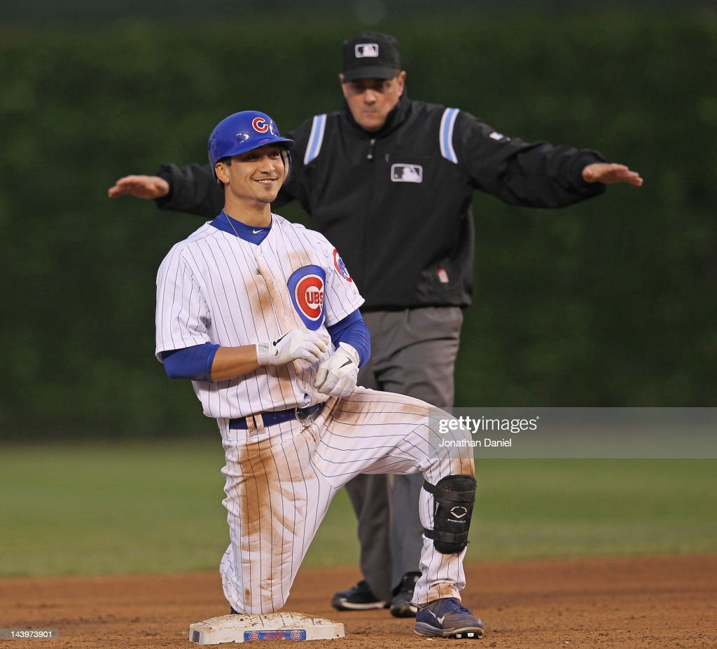 Darwin Barney #15 of the Chicago Cubs smiles after hitting a double in the 11 inning against the Los Angeles Dodgers as umpire Marty Foster #60 calls him safe at Wrigley Field on May 6, 2012 in Chicago, Illinois. The Cubs defeated the Dodgers 4-3 in 11 innings.