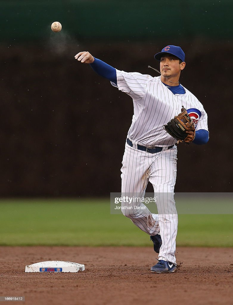 <a gi-track='captionPersonalityLinkClicked' href=/galleries/search?phrase=Darwin+Barney&family=editorial&specificpeople=537975 ng-click='$event.stopPropagation()'>Darwin Barney</a> #15 of the Chicago Cubs turns a double play against the Texas Rangers at Wrigley Field on April 18, 2013 in Chicago, Illinois. The Cubs defeated the Rangers 6-2.