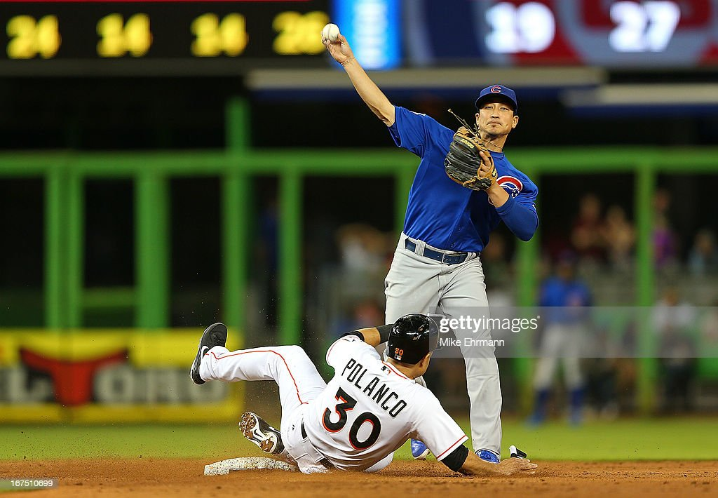 <a gi-track='captionPersonalityLinkClicked' href=/galleries/search?phrase=Darwin+Barney&family=editorial&specificpeople=537975 ng-click='$event.stopPropagation()'>Darwin Barney</a> #15 of the Chicago Cubs turns a double play as <a gi-track='captionPersonalityLinkClicked' href=/galleries/search?phrase=Placido+Polanco&family=editorial&specificpeople=213170 ng-click='$event.stopPropagation()'>Placido Polanco</a> #30 of the Miami Marlins slides into second during a game at Marlins Park on April 25, 2013 in Miami, Florida.