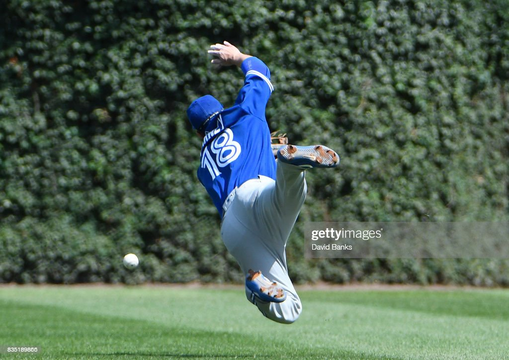 Darwin Barney #18 of the Toronto Blue Jays dives for a single hit by Albert Almora Jr. #5 of the Chicago Cubs during the second inning on August 18, 2017 at Wrigley Field in Chicago, Illinois.